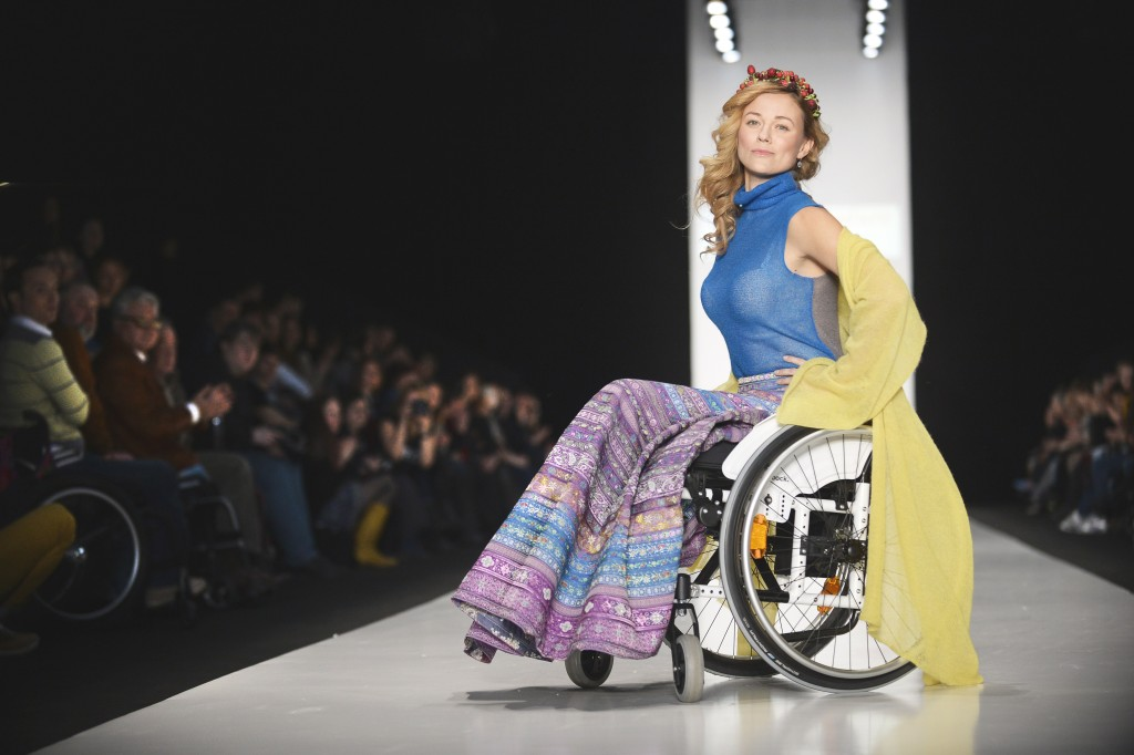 "A disabled model displays clothes designed for disabled people during ""Space Without Borders"" show of a Fashion Week in Moscow on March 31, 2014.   AFP PHOTO / ALEXANDER NEMENOV        (Photo credit should read ALEXANDER NEMENOV/AFP/Getty Images)"